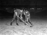1940s-1950s Ice Hockey Players Fighting for the Puck Reproduction photographique