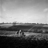 A Field in Hertfordshire, Being Ploughed by a Man on a Tractor Photographic Print by John Gay