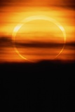 Eclipsed Sun Setting Photographic Print