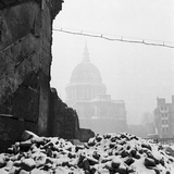 St Paul's Cathedral, London, the Cathedral in Mist with the Snow-Covered Ruins of a Bomb Photographic Print by John Gay