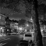 High Street, Hampstead, London. Parked Cars and Traffic in Hampstead High Street at Night Photographic Print by John Gay