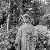 Highgate Cemetery, Hampstead, London, Statue of Girl Holding Lillies in the West Cemetery Photographic Print by John Gay