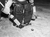 1940s-1950s Close-Up of Padded Goalie Shown Waist-Down Holding Stick with Puck in Front of Him Photographic Print