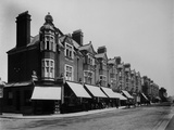 Warner Estate, Walthamstow, Greater London. Shops on the Warner Estate, Walthamstow Photographic Print by H. Bedford Lemere