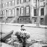 Boy Selling Flowers Photographic Print
