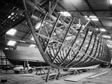 F B Wild's Boatyard, Horning, Norfolk, Interior View, Two Boats at Different Stages of Construction Photographic Print by Hallam Ashley