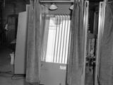 1950s Voting Booth Machine with Curtain Photographic Print