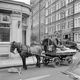 A Horse-Drawn Rag and Bone Cart Standing on the Road Outside the Builders Arms Public House Photographic Print by John Gay