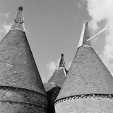 Cobham, Kent. Detail of Traditional Conical Roofs and Cowls of Oasthouses Near Cobham Photographic Print by Eric De Mere