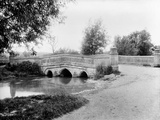 Bourton Bridge, Bourton-On-The-Water, Gloucestershire Photographic Print by Henry Taunt