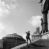 A Photographer Stands on the Steps of the Albert Memorial While Photographing the Royal Albert Hall Photographic Print by John Gay