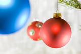 Close-Up of Hanging Red and Blue Christmas Baubles Photographic Print