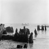 Walberswick Beach, Suffolk, Rotted Wooden Posts in the Sea at Walberswick Photographic Print by John Gay