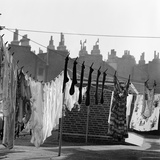 Lines of Washing Drying in the Sun with the Outlines of Roofs and Chimney Pots Behind Photographic Print by John Gay