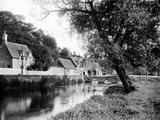 Bibury, Gloucestershire, Looking Along the River Towards the Stone Bridge Beside Arlington Row Photographic Print by Henry Taunt