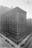 Aerial View of Stock Exchange Building with Parked Automobiles Photographic Print