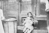 Children Sitting in a Doorway Photographic Print