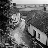 A View from an Elevated Position over an Unidentified Village Lane Photographic Print by John Gay