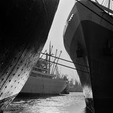 London Docks. the View Between Two Moored Ships to a Passenger Ship Behind Photographic Print by John Gay