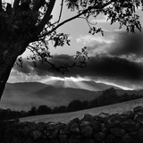 Lake District Landscape, Cumbria. Sun Behind Dark Cloud with Tree and Stone Wall in the Foreground Photographic Print by John Gay