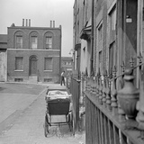 Swedenborg Square, Stepney, London, a Pram Stands on the Pavement Outside a House in Swedenborg Sq Photographic Print by Eric De Mere