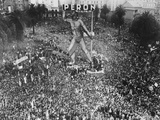 Massive Crowd Attending Rally under Statue with Peron Inscription Photographic Print
