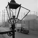 Kings Cross, London, a Street View with an Open Gas Street Light in the Foreground Photographic Print by John Gay