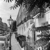 Looking Along the Pavement of a Residential Street Photographic Print by John Gay