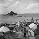 Marazion, Cornwall. a View over the Rooftops of Marazion to St Michaels Mount Photographic Print by John Gay