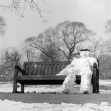 Regents Park, London, a Snowman Sitting on a Park Bench Photographic Print by John Gay