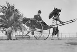 Man Riding in Rickshaw Reprodukcja zdjęcia