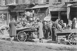 People Shopping around Push Cart Photographic Print