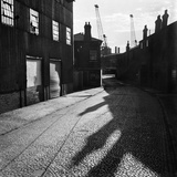 Dockyard, Essex. a Cobbled Road in an Industrial Dockyard Photographic Print by John Gay