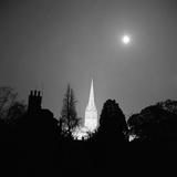Salisbury Cathedral, Wiltshire, the Cathedral Church of St Mary Towering over Buildings and Trees Photographic Print by John Gay