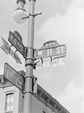 Street Light with Signs Photographic Print