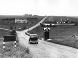 Stonehenge, Amesbury, Wiltshire, a Car Drives Past an Aa Box Towards Stonehenge Photographic Print
