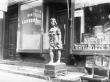 Statue of Indian in Front of Cigar Store Photographic Print