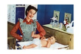 1940s Mother with Her Baby on a Changing Table in a Nursery Giclee Print