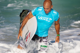 2012 Vans World Cup Of Surfing: Dec 4 - Kelly Slater Photographic Print by Kelly Cestari