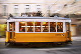 Europe, Portugal, Lisbon, a Speeding Tram (Streetcar) in the City Center Photographic Print by Alex Robinson