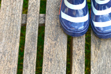 Blue Striped Rain Boots on a Wooden Floor Fotografiskt tryck av Laetitia Julien