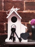 Keys on Birdhouse Photographic Print by Leon Le Baron