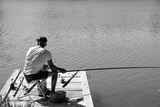 One Fisherman Waiting for the Fish to Bite the Hook Black and White Photographic Print by Laetitia Julien