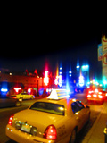 City Lights and Taxi Photographic Print by Gary Waters