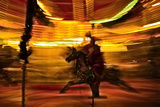 Spinning Carousel Photographic Print by Phil Payne