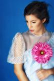 Woman in White Dress with a Flower Reproduction photographique par Ricardo Demurez