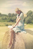 Sitting on a Haystack Photographic Print by Sabine Rosch