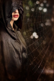 Woman in Black Hood Photographic Print by Ricardo Demurez