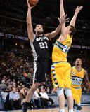 Mar 28, 2014, San Antonio Spurs vs Denver Nuggets - Tim Duncan Photo by Garrett Ellwood