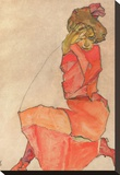 Kneeling Female in Orange-Red Dress, 1910 Stretched Canvas Print by Egon Schiele